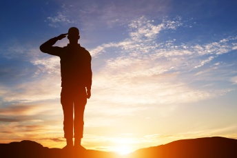 Soldier salute. Silhouette on sunset sky. War, army, military, guard concept.